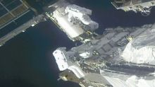 Spacewalking astronauts prep station for new solar wings