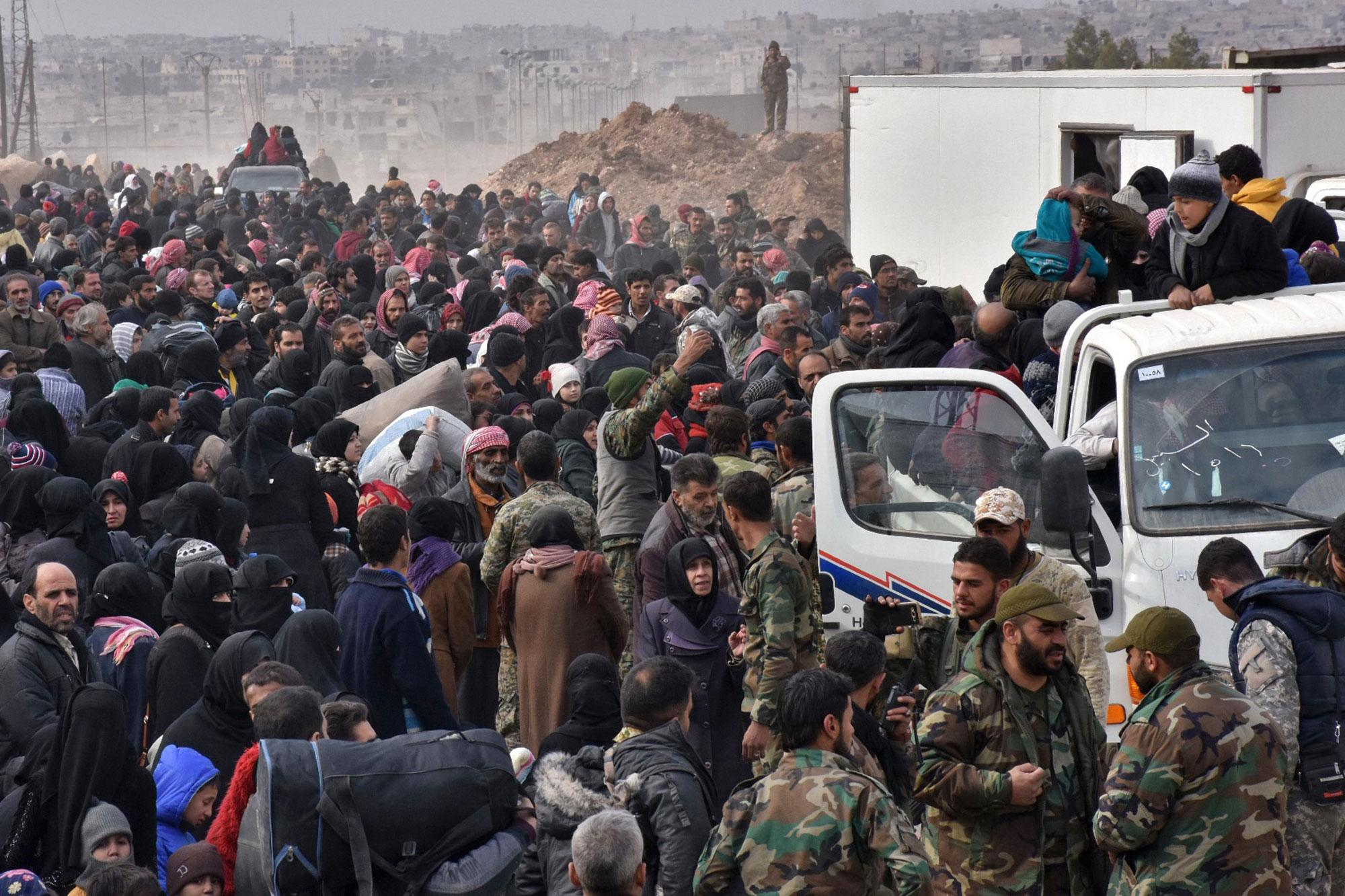 <p>Syrian families, fleeing from various eastern districts of Aleppo, queue to get onto governmental buses on November 29, 2016 in the government-held eastern neighbourhood of Jabal Badro, before heading to government-controlled western Aleppo, as the Syrian government offensive to recapture rebel-held Aleppo has prompted an exodus of civilians. The Syrian government offensive to recapture rebel-held Aleppo sparked international alarm, with the UN saying nearly 16,000 people had fled the assault and more could follow. The fighting has prompted an exodus of terrified civilians, many fleeing empty-handed into remaining rebel-held territory, or crossing into government-controlled western Aleppo or Kurdish districts. (George Ourfalian/AFP/Getty Images) </p>