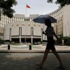 China raises market rates to fend off financial risks, growth cools