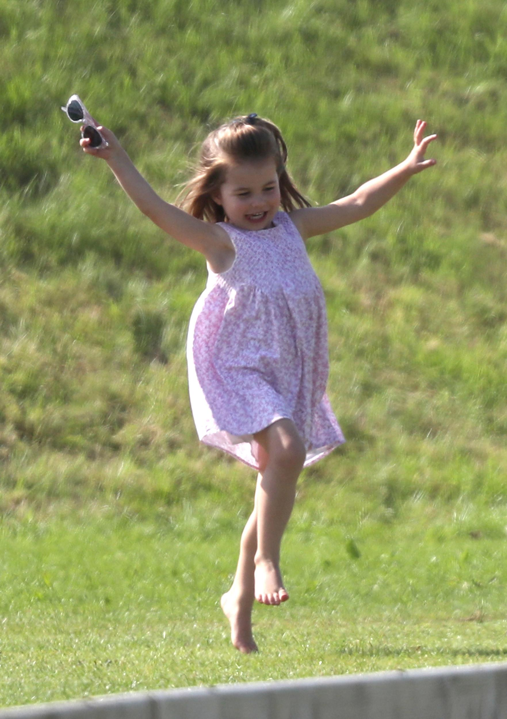 File photo dated 10/06/18 of Princess Charlotte playing as her father, the Duke of Cambridge, takes part in the Maserati Royal Charity Polo Trophy at the Beaufort Polo Club, Downfarm House, Westonbirt, Tetbury.