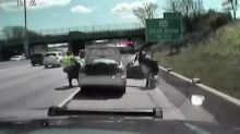 Driver reverses into officers at the side of the road