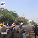 Myanmar forces set fires in Yangon amid protests