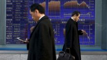 Asia stocks pressured as Wall St. hit by healthcare vote delay