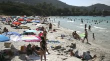 French minister defends 'precious' topless rights after sunbathers warned