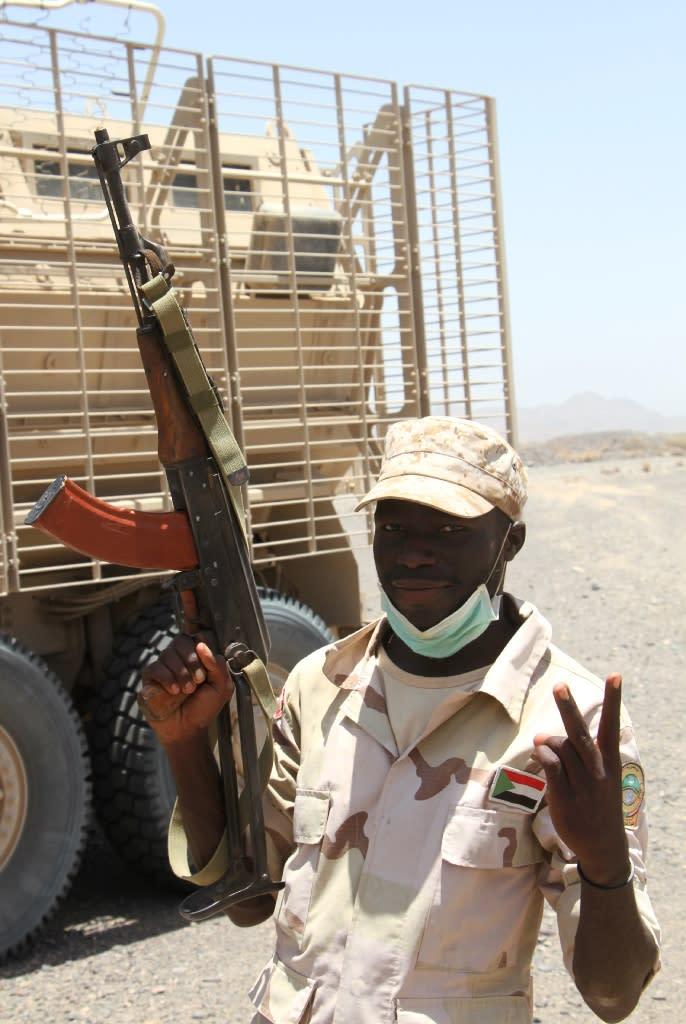 A Sudanese soldier flashes a victory sign outside the Yemeni coastal port town of Mokha (AFP Photo/SALEH AL-OBEIDI)