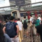 Train Passengers Walk to Station After Derailment in Hong Kong