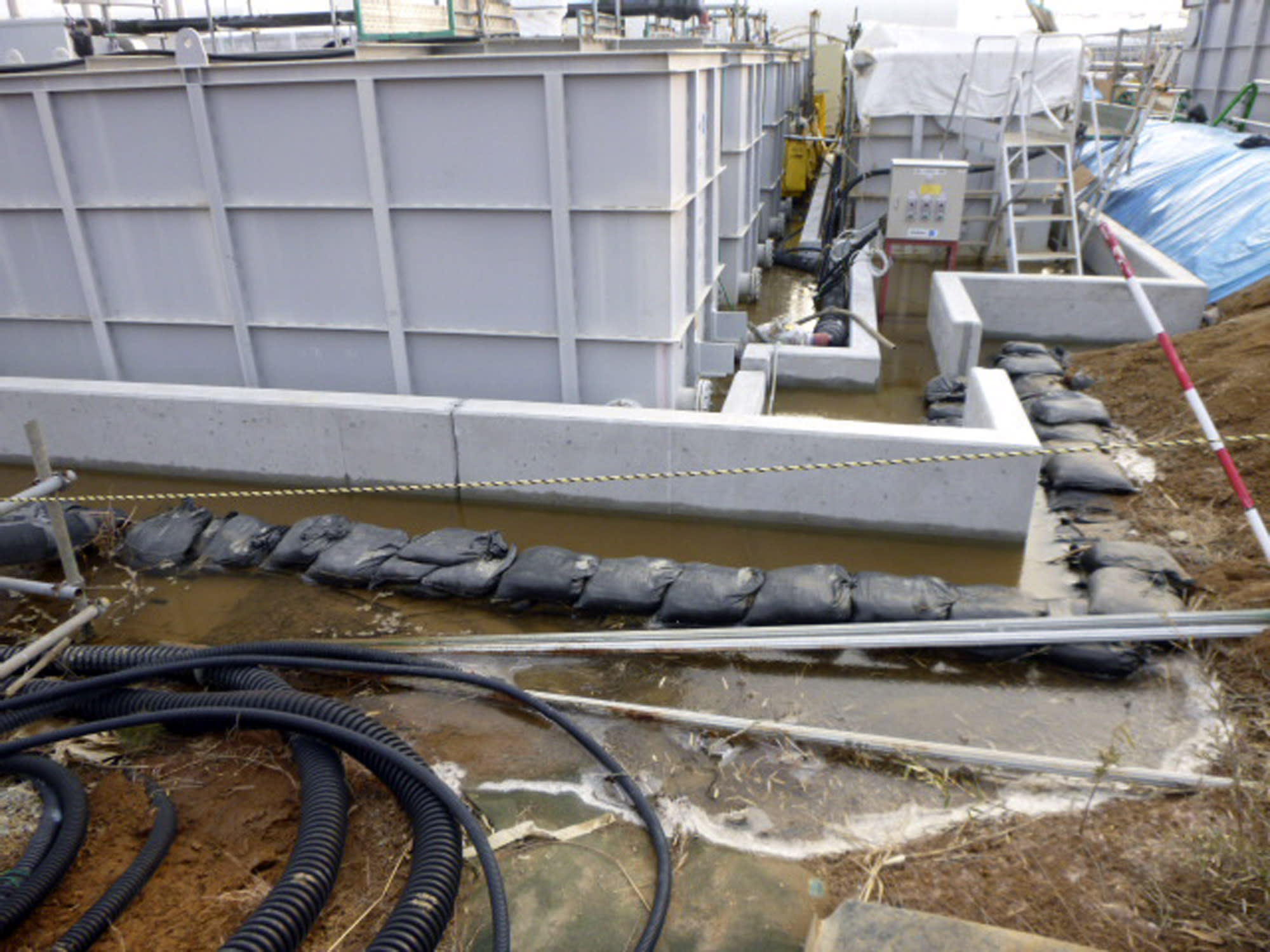 This photo released by Tokyo Electric Power Co. (TEPCO) shows radioactive water leaked from a tank at Fukushima Dai-ichi nuclear power plant in Okuma, Fukushima Prefecture Thursday, Feb. 20, 2014. Highly radioactive water has overflowed from a storage tank, but the operator says it did not reach the Pacific Ocean. The operator, TEPCO said Thursday that the leak involved partially treated water from early in the crisis, meaning it was more toxic than previous leaks. Three reactors melted at the Fukushima Dai-ichi plant following the 2011 earthquake and tsunami, with radioactive water partially recycled and stored in more than 1,000 tanks. (AP Photo/Tokyo Electric Power Co. )(AP Photo/Tokyo Electric Power Co. )