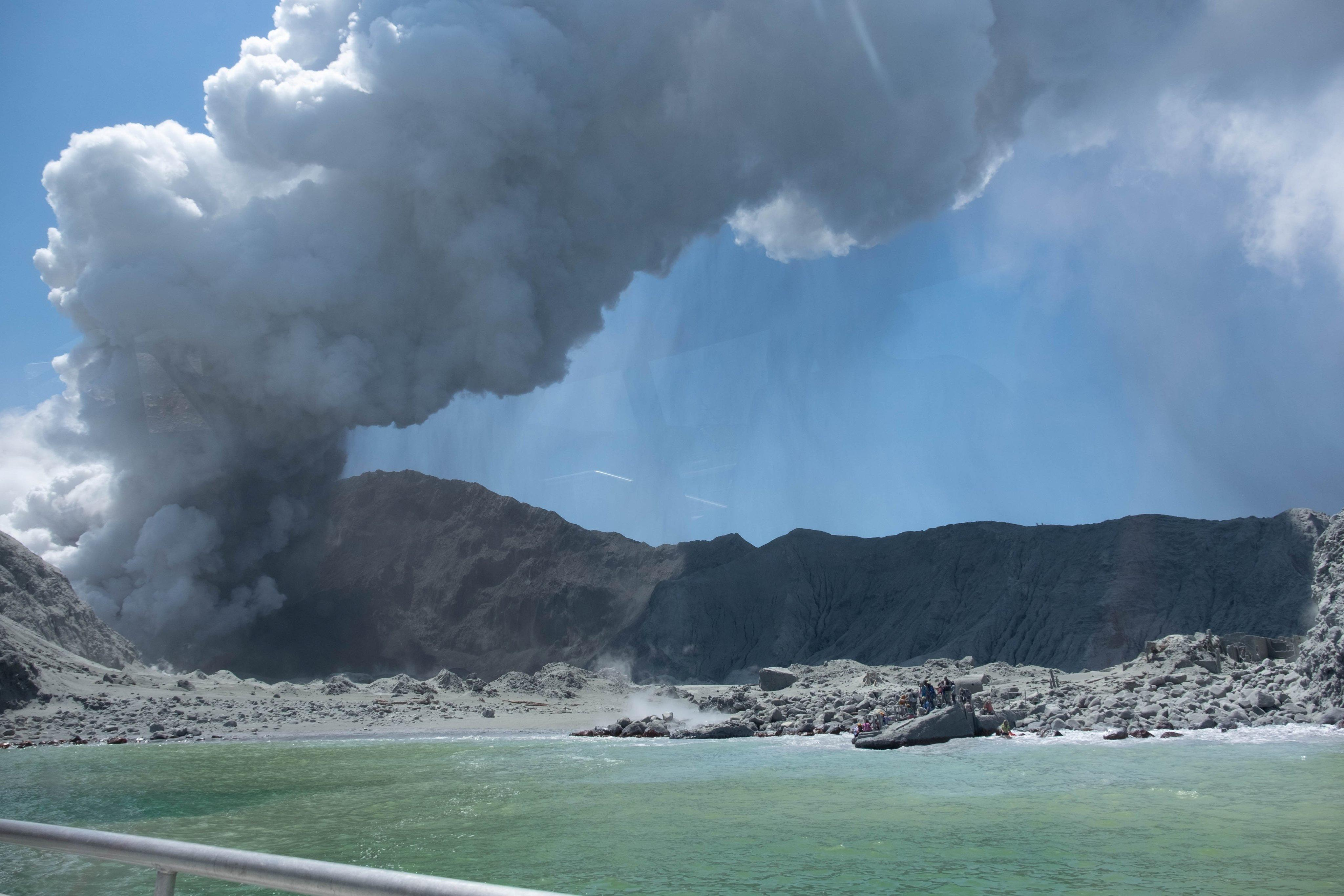 Tourist photos capture dramatic aftermath of New Zealand volcanic eruption