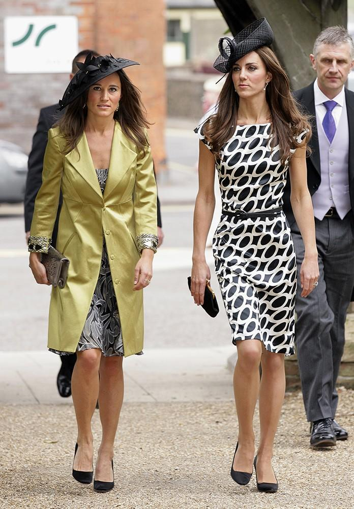 Kate and her sister Pippa attend a friend's wedding, both dressed in black and white patterned dresses and matching court shoes.