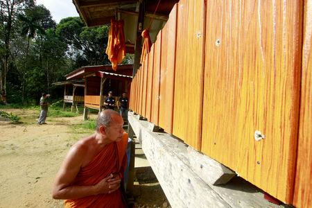 A buddhist monk looks at bullet holes on the wall of monk's shelter where two monks were injured on Friday at a temple in Su-ngai Padi district in the southern province of Narathiwat, Thailand, January 19, 2019. REUTERS/Surapan Boonthanom