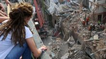 Rescuers sift Beirut rubble amid signs of life a month after blast