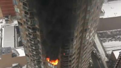 Raw: 2 Critically Injured in N.Y. High-rise Fire