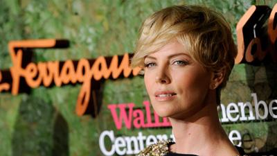 Theron, Moore Among Stars at Ferragamo Gala