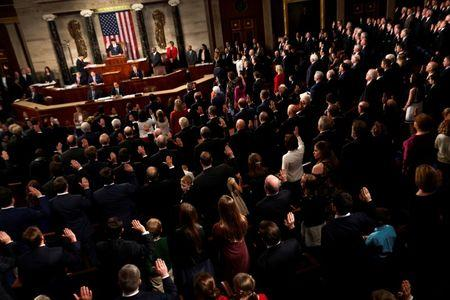 Members of the U.S. House of Representatives are sworn in on the House floor on the first day of the new session of Congress at the U.S. Capitol in Washington, U.S. January 3, 2017. REUTERS/Jonathan Ernst