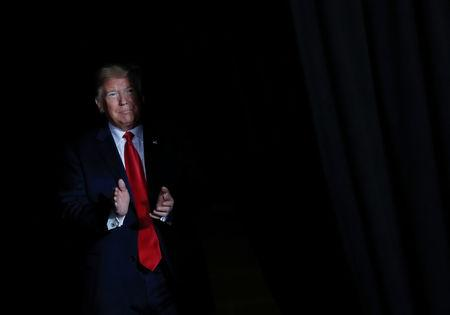 FILE PHOTO: U.S. President Donald Trump walks on stage at a campaign rally on the eve of the U.S. mid-term elections at the Show Me Center in Cape Girardeau