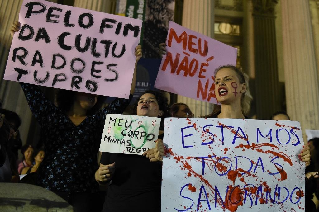 Brazilians protest in front of the Legislative Assembly of Rio de Janeiro on May 27, 2016, against a gang-rape of a 16-year-old girl (AFP Photo/Vanderlei Almeida)