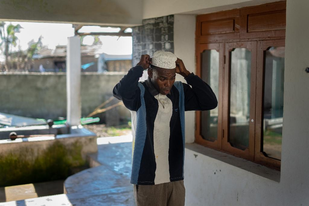 Rajabu Salima, 27, get ready for prayers. Some people have been sleeping in damaged mosques because their homes have been completely destroyed (AFP Photo/Zinyange Auntony)