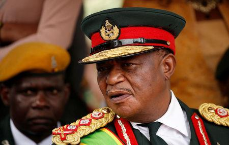 Commander of Zimbabwe Defence Forces General Constantino Chiwenga looks on after the swearing in of Emmerson Mnangagwa as Zimbabwe's new president in Harare, Zimbabwe, November 24, 2017. REUTERS/Siphiwe Sibeko