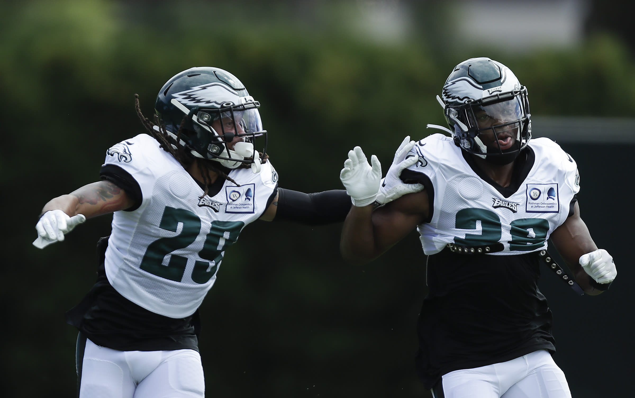 Philadelphia Eagles cornerback Avonte Maddox, left, and safety Rudy Ford work on coverage drills during an NFL football training camp practice in Philadelphia, Monday, Aug. 24, 2020. (Yong Kim/Pool Photo via AP)