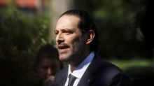After year of turmoil, Hariri returns as Lebanese premier