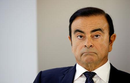 Image result for FILE PHOTO: Carlos Ghosn, chairman and CEO of the Renault-Nissan-Mitsubishi Alliance, attends a press conference on the second press day of the Paris auto show, in Paris, France, October 3, 2018. REUTERS/Regis Duvignau/File Photo