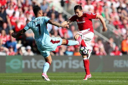 Burnley's Andre Gray in action with Middlesbrough's Stewart Downing
