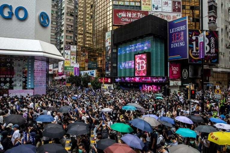 Pro-democracy protesters gather in Causeway Bay district of Hong Kong on May 24 (AFP Photo/ISAAC LAWRENCE)