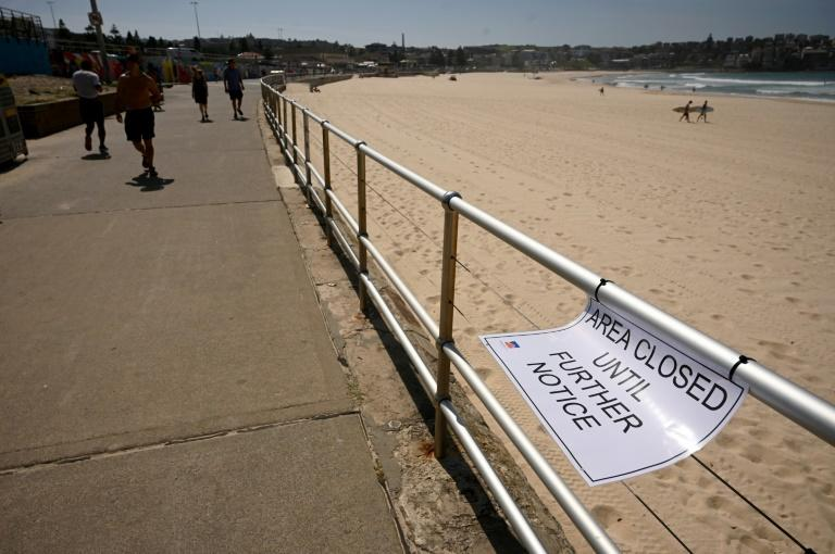 Sydney's Bondi Beach was closed after huge crowds flocked to the popular sunbathing spot despite a government ban on large gatherings (AFP Photo/PETER PARKS)