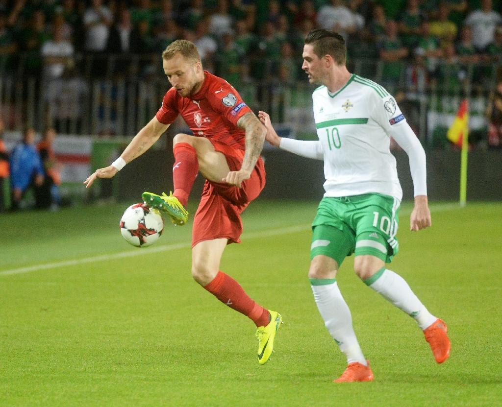 Michal Kadlec of Czech Republic (L) fights for the ball with Kyle Lafferty of Northern Ireland during their 2018 World Cup qualification match, in Prague, on September 4, 2015 (AFP Photo/Michal Cizek)