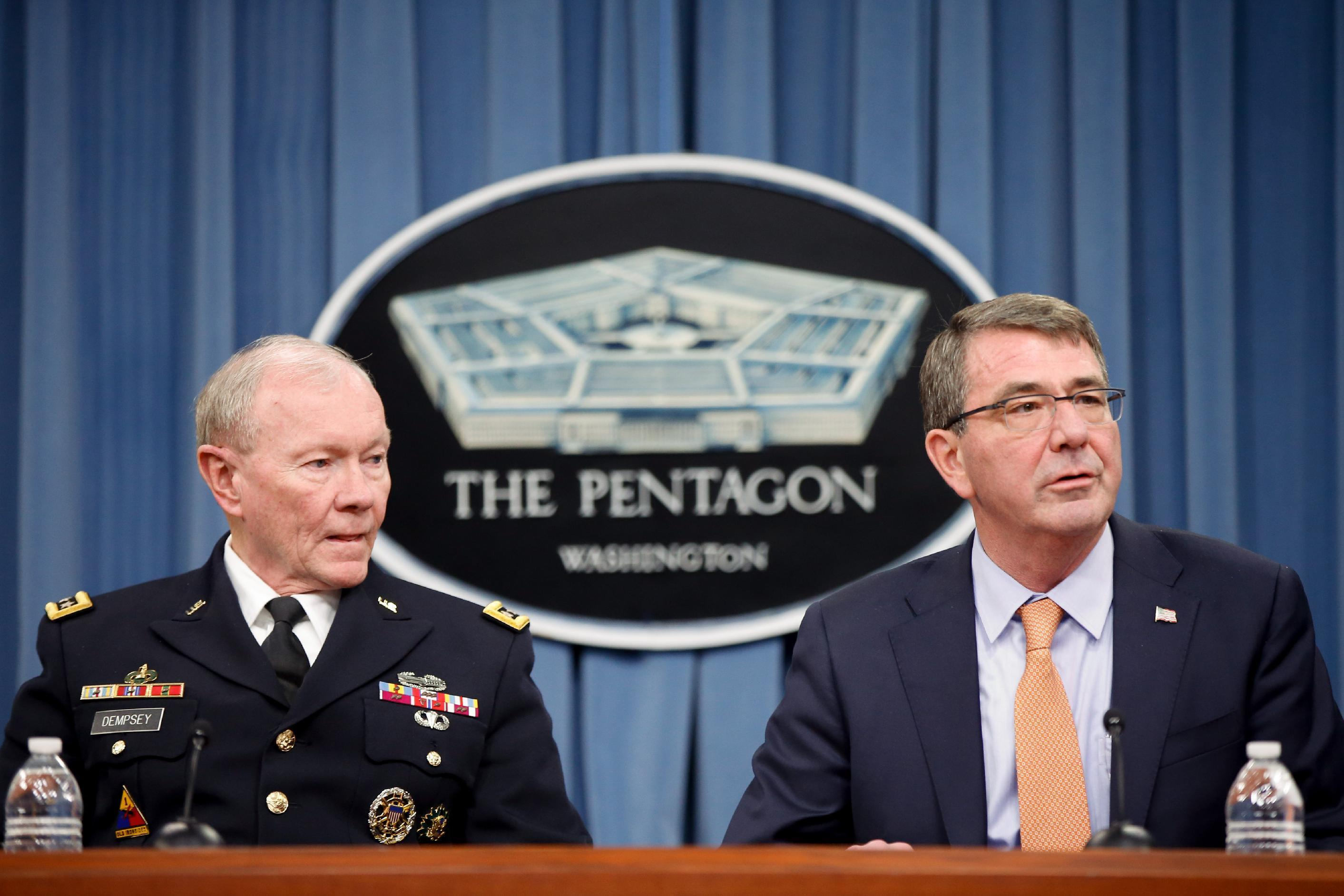 FILE - In this April 16, 2015, file photo, Defense Secretary Ash Carter, right, accompanied by Joint Chiefs Chairman Gen. Martin Dempsey, left, speaks during a news conference at the Pentagon. Two of America's top military leaders will be asked to defend President Barack Obama's handling of the tinderbox of violence and struggle in the Middle East. Defense Secretary Ash Carter and Gen. Martin Dempsey, who is finishing a four-year stint as chairman of the Joint Chiefs of Staff, are to appear Wednesday, June 17, 2015, before the House Armed Services Committee. (AP Photo/Andrew Harnik, File)