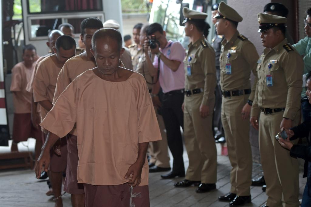 Suspects facing human trafficking charges arrive at the criminal court in Bangkok on November 10, 2015 (AFP Photo/Pornchai Kittiwongsakul)