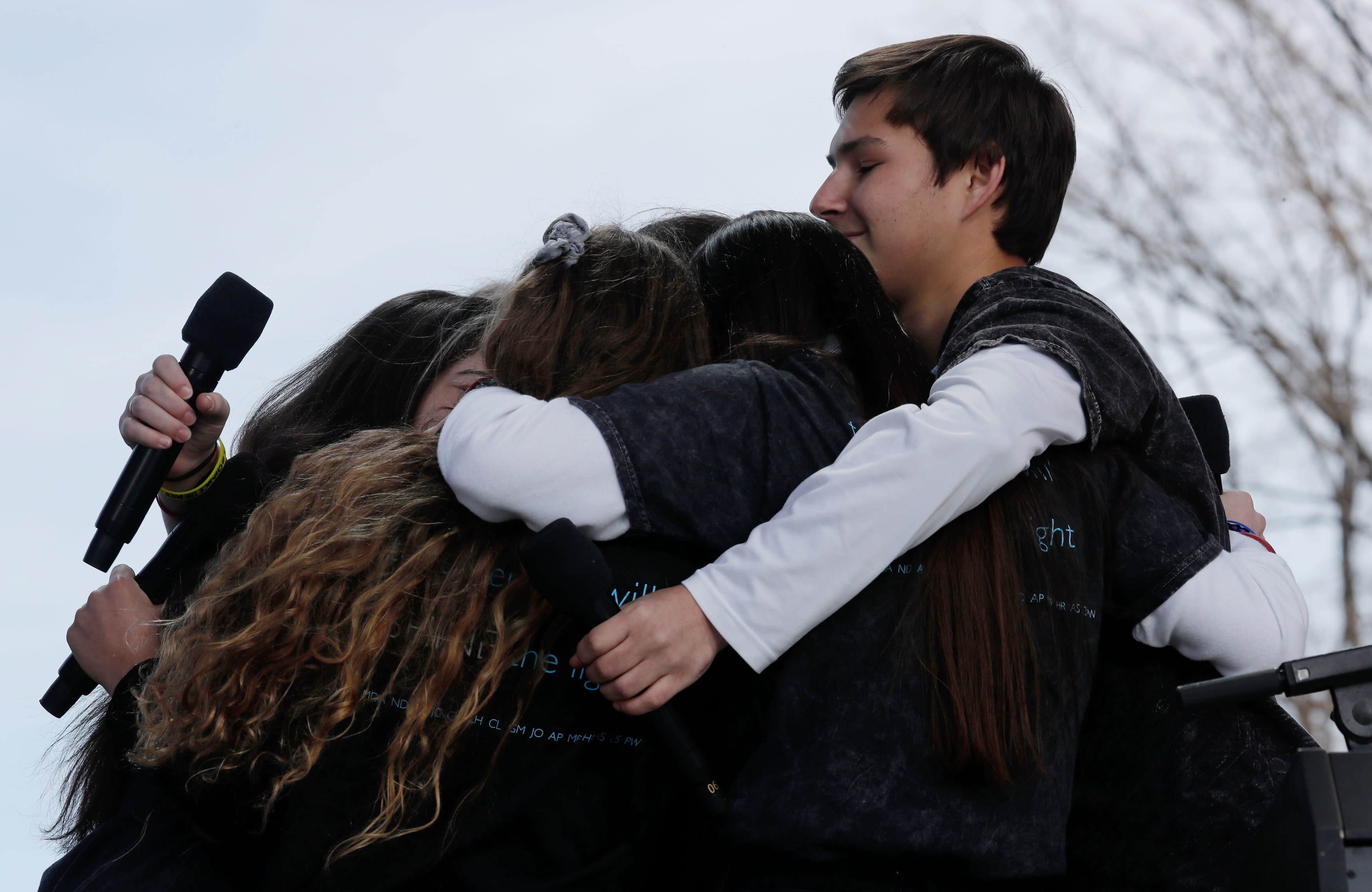"""<p>Students and school shooting survivors embrace at the conclusion of the """"March for Our Lives"""" event demanding gun control after recent school shootings at a rally in Washington, U.S., March 24, 2018. (Jonathan Ernst/Reuters) </p>"""