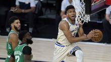 Controversial calls surround Giannis Antetokounmpo in Bucks' bubble-opening win