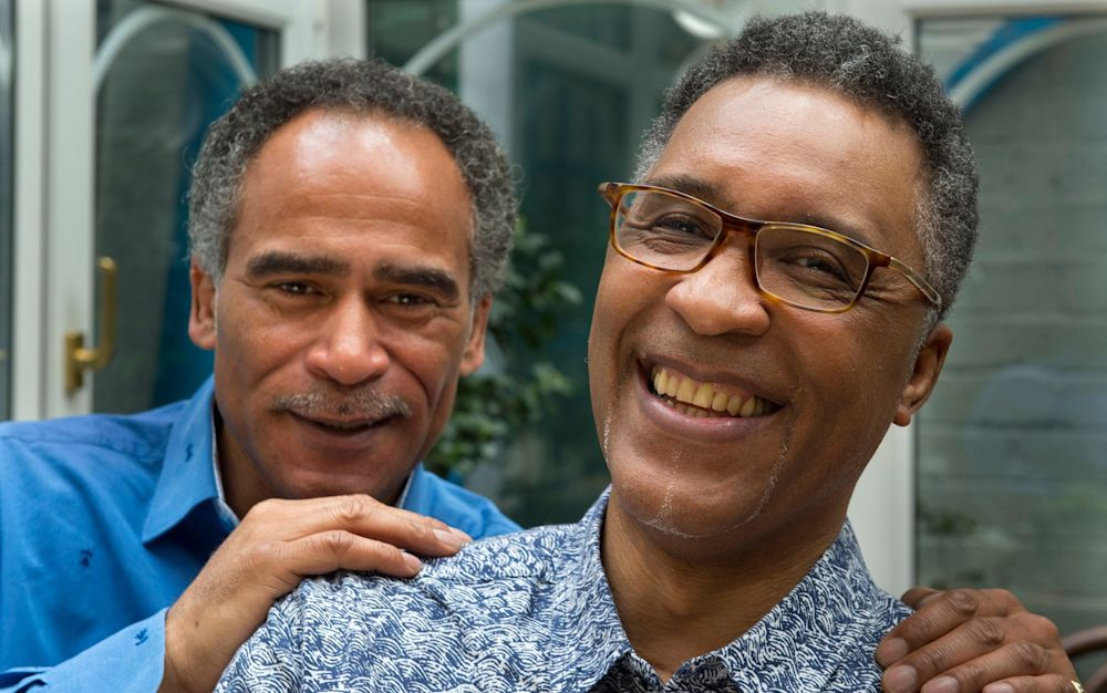 Former Boxer Michael Watson (right) with his friend and carer Lenny Ballack - JULIAN SIMMONDS