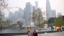 Haze readings across Singapore remain at 'unhealthy' levels
