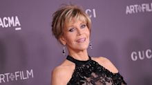 Jane Fonda, 79, works the off-the-shoulder look on the red capet