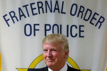 FILE PHOTO - Republican presidential candidate Donald Trump speaks to police gathered at Fraternal Order of Police lodge during a campaign event in Statesville