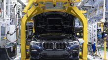 BMW Caves In to Trade, Pricing Pressures With Profit Cut