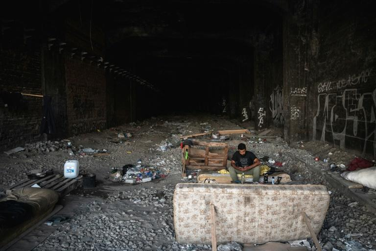 A lonely migrant from Syria on his journey towards Germany, rests in an abandoned railway tunnel in Belgrade