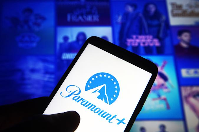 UKRAINE - 2021/06/29: In this photo illustration, Paramount+ (Paramount Plus) logo is seen on a smartphone against its website in the background. (Photo Illustration by Pavlo Gonchar/SOPA Images/LightRocket via Getty Images)