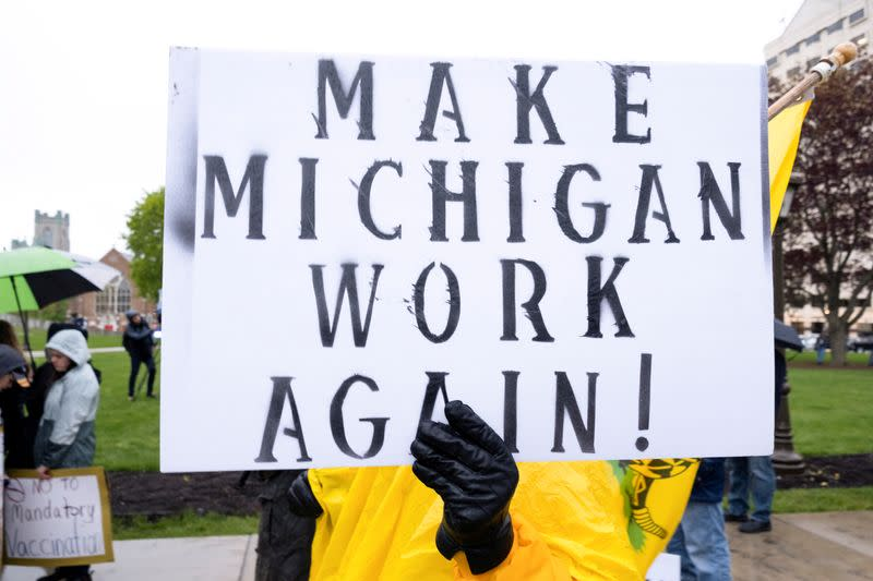 FILE PHOTO: Protesters against the state's extended stay-at-home order demonstrate in Lansing