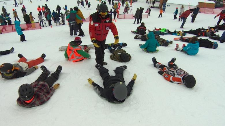 Skiers and boarders lay down for a world record attempt at Spring Hill