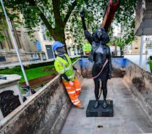 Statue of Black Lives Matter protester on Colston plinth is removed by Bristol Council