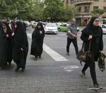 Assault on woman by Iranian cops sparks headscarves debate