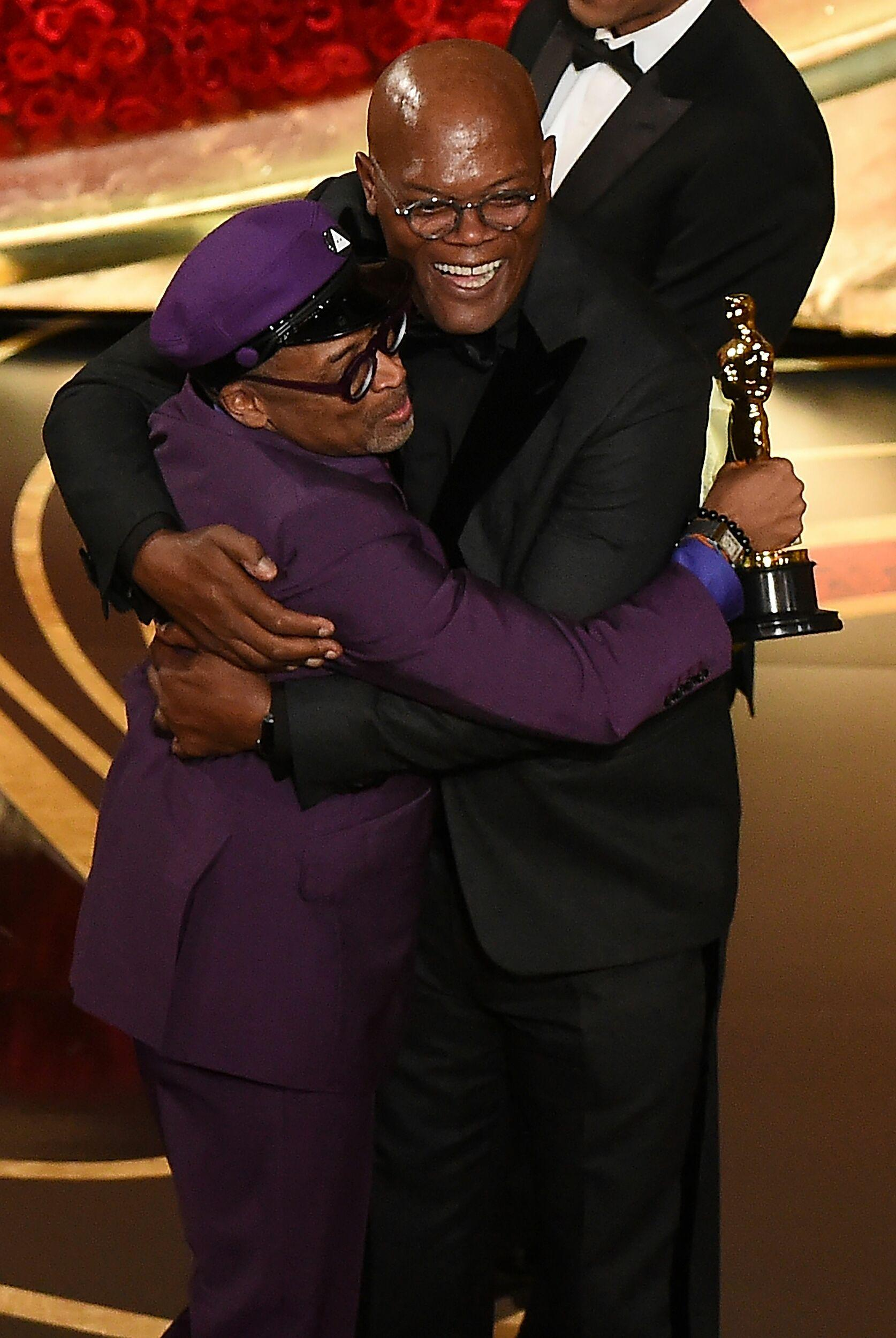 Best Adapted Screenplay nominee for 'BlacKkKlansman' Spike Lee embraces actor Samuel L. Jackson as he accepts the award for Best Original Screenplay during the 91st Annual Academy Awards at the Dolby Theatre in Hollywood, California on February 24, 2019. (Photo by VALERIE MACON / AFP)        (Photo credit should read VALERIE MACON/AFP/Getty Images)
