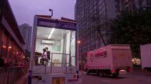 Hong Kong piano teacher offers lessons on a truck