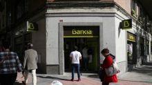 Bankia profit drops, net interest income stabilises