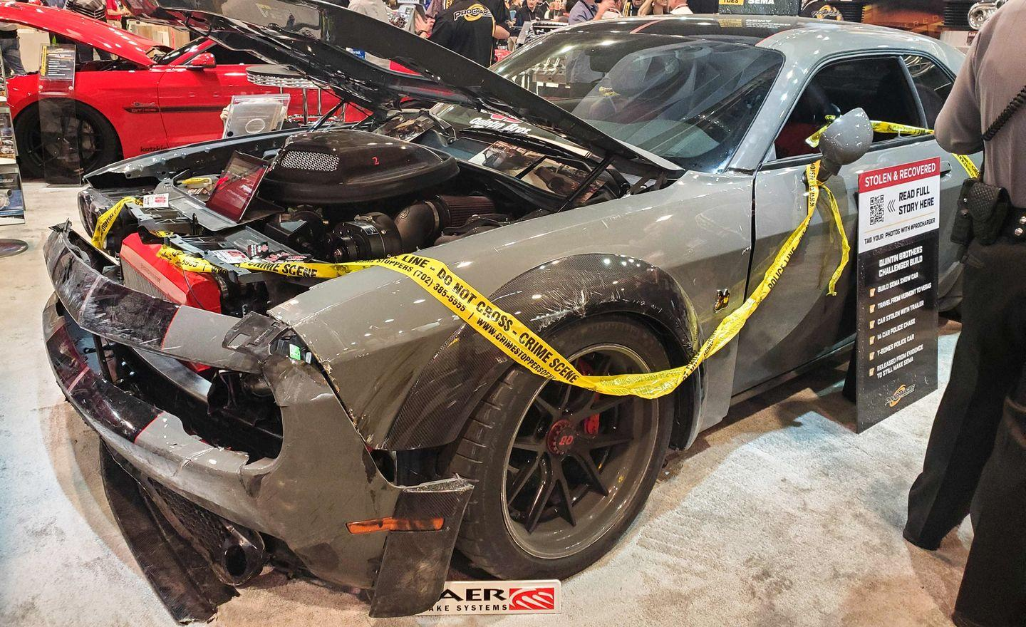 """<p>This 1000-hp Dodge Challenger went on<a href=""""https://www.caranddriver.com/news/a29724966/dodge-challenger-stolen-sema-car-news/"""" rel=""""nofollow noopener"""" target=""""_blank"""" data-ylk=""""slk:a wild adventure"""" class=""""link rapid-noclick-resp""""> a wild adventure</a> after it arrived in Las Vegas. Vermont-based Quintin Brothers Auto & Performance had their truck and trailer stolen days before the show. Their custom Challenger was inside. Video surveillance helped track down the perp, but when Nevada state trooper Adam Whitmarsh tried to block the stolen Challenger into a parking space, the suspect rammed the Trooper's Ford Explorer and escaped. After exiting the parking structure, the suspect smashed through a fence and drove the stolen Challenger across a nearby karting track—during a karting event. He eventually ditched the car and was later arrested. The Quintin Brothers and their Dodge Challenger arrived at the SEMA show wearing battle wounds from the wild chase, and their crew was thankful they were able to show off all their hard work.</p>"""