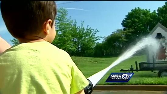 Special needs kids learning from firefighters