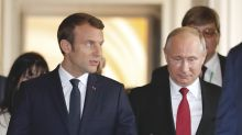 The Latest: Macron attacks Russian media outlets